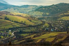 Village in the valley. mysterious autumn weather. Village in the valley. bird eye view. rail road and viaduct in the distance. mysterious autumn weather stock image
