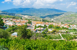 The village in the valley. The picturesque village of Omodos located in the mountain valley and surrounded by agriculture lands and fruit gardens, Cyprus Stock Image