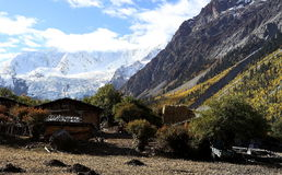 Village in the valley. Scenic view of tibetan village. Some local villagers are living here in cottages Royalty Free Stock Photo