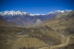 Village in the valley surrounded Himalayan peaks Royalty Free Stock Photo