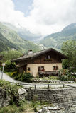Village in the valley of swiss Alps Stock Images