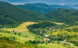 Village in the valley. view from the top of a hill. Beautiful summer scenery in mountains Royalty Free Stock Photography