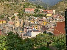 Village of Vernazza, Italy, huddles between hills, as viewed fro. Oct 2017: Looking down on the village of Vernazza, Cinque Terre, Italy stock photography