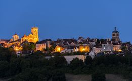 Village Vezelay Basilica at Night. The UNESCO village of Vezelay on a hill with the Benedictine abbey and church of Saint Mary Magdalene at night in Yonne royalty free stock photo