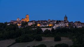 Village Vezelay with Basilica at Night. The UNESCO village of Vezelay on a hill with the Benedictine abbey and church of Saint Mary Magdalene at night in Yonne stock images