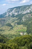 Village view from high ground. Small village in the mountains, with a monastery nearby Royalty Free Stock Image
