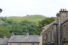 A village view into the hills beyond. A view over village stone houses to the limestone hills beyond Stock Images