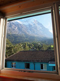Village view from window at Jungefrau Switzerland. Village view from window at Jungefrau above Grindelwald, Switzerland with Village Background Royalty Free Stock Photos