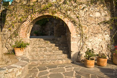 Village Walkway. A stone archway along a pedestrian pathway in historic San Miguel de Allende royalty free stock images