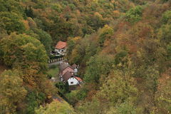 Village in walley. Village Karlstejn - houses hidden between hills with forests in walley (Czech Republic Royalty Free Stock Images
