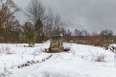 Village water well in the winter in the wild place Stock Images