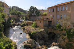 Village with waterfall, Provence, France. Royalty Free Stock Images