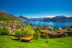 Village Weggis, Lake Lucerne, Pilatus mountain and Swiss Alps in the background near famous Lucerne city Stock Photos