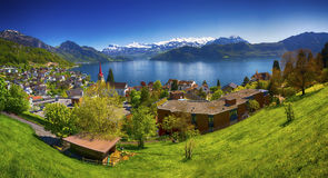 Village Weggis, lake Lucerne, Pilatus mountain and Swiss Alps in the background near Lucerne city Royalty Free Stock Images