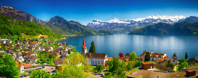 Village Weggis and lake Lucerne surrounded by Swiss Alps. Panorama image of village Weggis, lake Lucerne (Vierwaldstatersee), Pilatus mountain and Swiss Alps in stock image