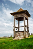 Village well on green hill Royalty Free Stock Photo