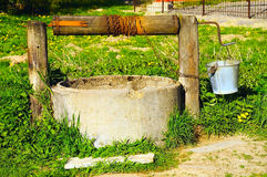 Village well in summer. Rural view of well in the village Stock Images