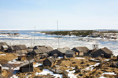 Village on a White sea Stock Images