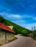 Village. Winding road in romanian village Stock Photography