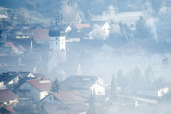 Village in winter fog Royalty Free Stock Images