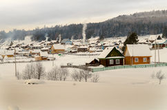 Village in winter in mountains Stock Photography