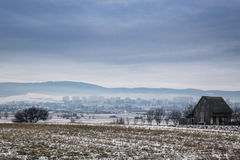 Village in winter time. Romanian hills in winter time Royalty Free Stock Photography