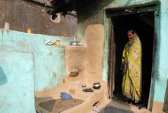Village woman in a house. Royalty Free Stock Photography
