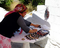 Village woman preparing her local stall Stock Images