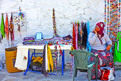 Village woman selling hand-knitted gifts Royalty Free Stock Photo