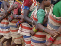 Village women link arms for  Gdaba harvest dance Royalty Free Stock Photo