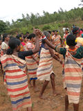 Village women link arms for  Gdaba harvest dance Royalty Free Stock Photos