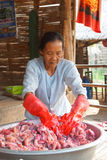 Village women preparing fermented sour fish Stock Photography
