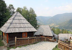 Village with wooden cabin log Stock Photography