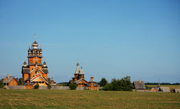 Village with a wooden church. Village with traditional wooden houses and church Stock Photo