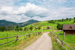 Village with the wooden houses nearby forest in the mountains Royalty Free Stock Images
