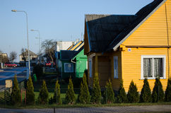 Village wooden painted house along the street Royalty Free Stock Photo