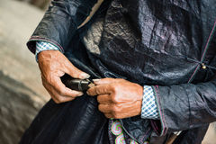 Villager of a chinese minority refilling gun powder. Villager of the Chinese Miao chinese minority refilling gun powder Stock Photography