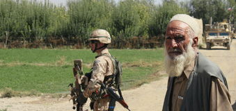 Villager with czech trooper. Villager cooperating with coalition forces in afghanistan Royalty Free Stock Photography