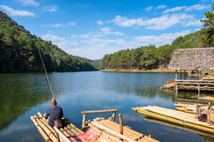 Villager fishing on reservoir in sunny at pang oung. Mae hong son,thailand Royalty Free Stock Photography