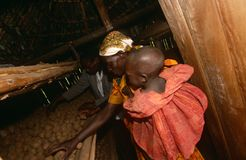 Villager in a food store in Uganda Stock Photo