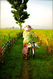 Villager life. A villager with her bicycle Stock Images