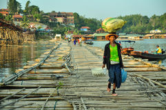 Villager walk on bamboo raft. In Sangklaburi, Karnjanaburi, Thailand Royalty Free Stock Photos
