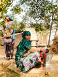 Villager washing clothes. Village ladies washing clothes using hand pump Royalty Free Stock Images
