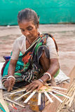 Villager weaving handicraft items Stock Images