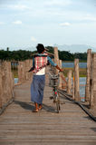 Villagers bike trailers on Uben bridge,Myanmar. Royalty Free Stock Photos