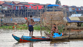 Villagers on boat, Tonle Sap, Cambodia Stock Image