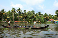 Villagers bring drinking water in big plastic cans on a boat in the backwaters royalty free stock image