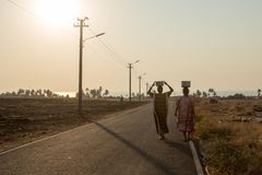 Villagers carry water in a remote part of India royalty free stock photo