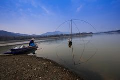 Villagers are catching fish by fish trap net trap. In reservoir royalty free stock photos