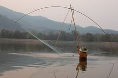 Villagers are catching fish by fish trap net trap. In reservoir royalty free stock image